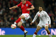 Gareth Barry of England beats Hossam Ghaly of Egypt to the ball during the International Friendly match between England and Egypt at Wembley Stadium on March 3, 2010 in London, England.
