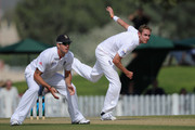 Stuart Broad of England bowls alongside Kevin Pietersen during the tour match between England and ICC Combined AM XI at ICC Global Academy on January 7, 2012 in Dubai, United Arab Emirates.