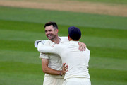 James Anderson of England celebrates with Jonny Bairstow of England after taking the final wicket of Mohammed Shami to become the record test wicket taker for a pace bowler during day five of the Specsavers 5th Test match between England and India at The Kia Oval on September 11, 2018 in London, England.