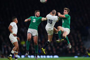 Mike Brown of England competes for the ball with Stuart McCloskey (L) of Ireland and Andrew Trimble (R) of Ireland during the RBS Six Nations match between England and Ireland at Twickenham Stadium on February 27, 2016 in London, England.