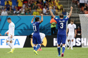 Andrea Pirlo and Giorgio Chiellini of Italy celebrate their team's win as Ross Barkley (L) and Steven Gerrard of England (R) look on during the 2014 FIFA World Cup Brazil Group D match between England and Italy at Arena Amazonia on June 14, 2014 in Manaus, Brazil.