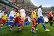 Andrea Pirlo of Italy walks into the pitch followed by Salvatore Sirigu and Giorgio Chiellini before the 2014 FIFA World Cup Brazil Group D match between England and Italy at Arena Amazonia on June 14, 2014 in Manaus, Brazil.