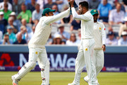 Mohammad Amir of Pakistan celebrates bowling out Alastair Cook of England with team mate Sarfraz Ahmed of Pakistan during the NatWest 1st Test match between England and Pakistan at Lord's Cricket Ground on May 24, 2018 in London, England.