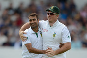 Imran Tahir of South Africa celebrates with Graeme Smith dismissing Matt Prior of England during day four of the 2nd Investec Test match between England and South Africa at Headingley on August 5, 2012 in Leeds, England.