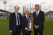 ECB Chairman Colin Graves (centre) presents Surrey CCC President David Stewart (L) and Surrey CCC Chairman Richard Thompson with a silver bat in honour of the Oval's 100th test match ahead of Day One of the 3rd Investec Test between England and South Africa at The Kia Oval on July 27, 2017 in London, England.