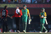Morne Morkel and Imran Tahir of South Africa shake hands after losing the match during the  2011 ICC World Cup Group B match between England and South Africa at the M. A. Chidambaram Stadium on March 6, 2011 in Chennai, India.