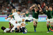 Ben Youngs of England performs a box kick as Pieter-Steph du Toit of South Africa attempts to charge down during the Rugby World Cup 2019 Final between England and South Africa at International Stadium Yokohama on November 02, 2019 in Yokohama, Kanagawa, Japan.