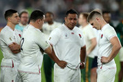 (R-L) Owen Farrell, the England captain looks dejected with team mates Mako Vunipola, Jamie George and Ben Youngs after their defeat during the Rugby World Cup 2019 Final between England and South Africa at International Stadium Yokohama on November 02, 2019 in Yokohama, Kanagawa, Japan.