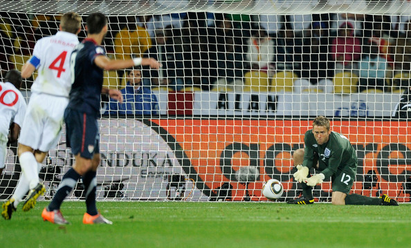 Robert Green of England misjudges the ball and lets in a goal during the 2010 FIFA World Cup South Africa Group C match between England and USA at the Royal Bafokeng Stadium on June 12, 2010 in Rustenburg, South Africa.