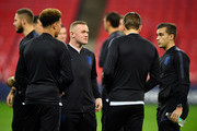 Wayne Rooney of England speaks with teammates during a pitch inspection prior to the International Friendly match between England and United States at Wembley Stadium on November 15, 2018 in London, United Kingdom.