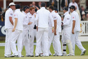 Jonny Bairstow of England is congratulated by his team mates after his throw dismissed Kirk Edwards of West indies off the bowling of Stuart Broad of England during day three of the 1st Investec Test Match between England and the West Indies at Lord's Cricket Ground on May 19, 2012 in London, England.