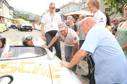 Patrick Dempsey talks to Sir Stirling Moss at the Ennstal Classic 2015 on July 17, 2015 in Schladming, Austria.