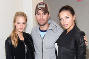 """Singer Enrique Iglesias poses with Victorias Secret models Erin Heatherton (L) and Adriana Lima during the Enrique Iglesias 2011 """"Euphoria"""" tour at the Prudential Center on September 24, 2011 in Newark, New Jersey."""