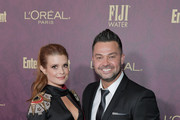 JoAnna Garcia Swisher (L) and Nick Swisher attend the 2018 Pre-Emmy Party hosted by Entertainment Weekly and L'Oreal Paris at Sunset Tower on September 15, 2018 in Los Angeles, California.