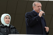 "Turkish President Tayyip Erdogan delivers a referendum victory speech to his supporters at Ankara Esenboga Airport on April 17, 2017 in Ankara Turkey. Erdogan declared victory in Sunday's historic referendum that will grant sweeping powers to the presidency, hailing the result as a ""historic decision. 51.4 per cent per cent of voters had sided with the ""Yes"" campaign, ushering in the most radical change to the country's political system in modern times.Turkey's main opposition calls on top election board to annul the referendum. OSCE observers said that a Turkish electoral board decision to allow as valid ballots that did not bear official stamps undermined important safeguards against fraud."