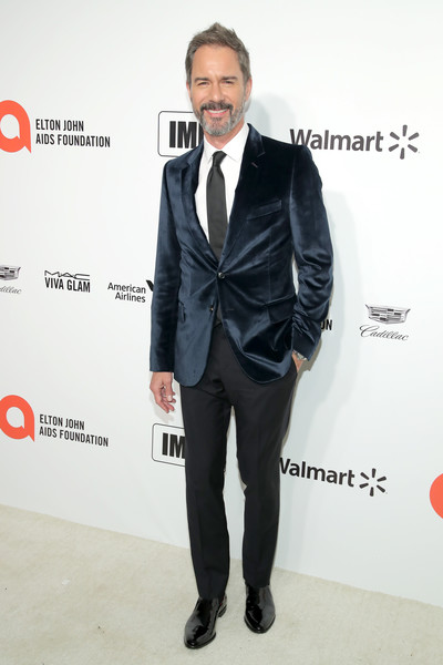 28th Annual Elton John AIDS Foundation Academy Awards Viewing Party Sponsored By IMDb, Neuro Drinks And Walmart - Arrivals [suit,clothing,formal wear,tuxedo,tie,blazer,fashion,outerwear,bow tie,carpet,neuro drinks,arrivals,elton john aids foundation academy awards viewing party,eric mccormack,west hollywood,california,walmart,imdb,elton john,academy awards,oscar party,party,celebrity,hollywood,getty images,elton john aids foundation,elton john aids foundation academy award party]