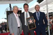 (L-R) Michael Douglas, Eric McCormack and Max Mutchnick attend Eric McCormack being honored with a Star on the Hollywood Walk of Fame on September 13, 2018 in Hollywood, California.