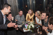 "(L-R) Eric Podwall, JC Chasez, Bryan Singer, Sophie Turner, Candice Crawford, and Tony Romo attend ""The Evening Before""- a pre-White House Correspondents' Dinner party hosted by Eric Podwall and Spotify at Chaplin's Restaurant on April 24, 2015 in Washington, DC."