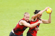 Jake Long is tackled by Jake Stringer during an Essendon Bombers AFL training session at The Hangar on March 20, 2018 in Melbourne, Australia.