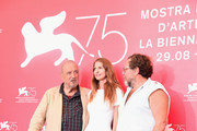 (L-R) Jean-Claude Carriere, Louise Kugelberg and Julian Schnabel attend 'At Eternity's Gate' photocall during the 75th Venice Film Festival at Sala Casino on September 3, 2018 in Venice, Italy.