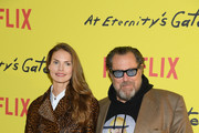 """. Julian Schnabel and Louise Kugelberg attend the Photocall for """"At Eternity's Gate"""" film at Musee du Louvre on April 02, 2019 in Paris, France."""