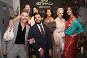 (L-R) Eric Rutherford, Montana Cox, Chanel Iman, Vice President of Commercial Partnerships for Etihad Airways, Yasser Al Yousef, Georgia Fowler, Maye Musk and Candice Huffine attend the Etihad Airways cocktail party during NYFW: The Shows at Spring Studios on September 10, 2019 in New York City.
