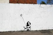 A Banksy mural is modified to depict the current Covid-19 Pandemic on April 19, 2020 in Southampton, England. In a press conference on Thursday, First Secretary of State Dominic Raab announced that the lockdown will remain in place for at least 3 more weeks. The Coronavirus (COVID-19) pandemic has spread to many countries across the world, claiming over 160,000 lives and infecting more than 2 million people.