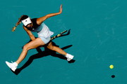 Caroline Wozniacki of Denmark hits a ball between her legs while playing Monica Niculescu of Romania during the Miami Open Presented by Itau at Hard Rock Stadium March 23, 2019 in Miami Gardens, Florida.