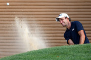 Edoardo Molinari of Italy plays a shot out of the bunker during round two of the Hero Indian Open at the DLF Golf & Country Club on March 29, 2019 in New Delhi, India.