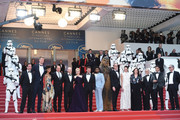 (L-R)  Producer Simon Emanuel, actor Joonas Suotamo, actress Thandie Newton, actor Woody Harrelson, director Ron Howard, actress Emilia Clarke, actor Alden Ehrenreich, actor Donald Glover, Chewbacca, Paul Bettany and Phoebe Waller-Bridge and members of the cast, attend the European Premiere of 'Solo: A Star Wars Story' at Palais des Festivals on May 15, 2018 in Cannes, France.