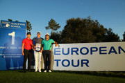 (L-R) Daniel Im of the USA, Ulrich Van den Berg of South Africa and Adrian Otaegui of Spain pose with the winners trophy after all finishing jointly on -18 under par during the final round of the European Tour Qualifying School Final at PGA Catalunya Resort on November 19, 2015 in Girona, Spain.