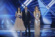 (L-R) Hosts Lucy Ayoub, Erez Tal and Bar Refaeli  at the 64th annual Eurovision Song Contest held at Tel Aviv Fairgrounds on May 17, 2019 in Tel Aviv, Israel.