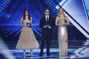 (L-R) Hosts Lucy Ayoub, Erez Tal and Bar Refaeli live on stage during the 64th annual Eurovision Song Contest held at Tel Aviv Fairgrounds on May 18, 2019 in Tel Aviv, Israel.