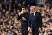 Roy Hodgson, Manager of Crystal Palace and Marco Silva, Manager of Everton looks on during the Premier League match between Everton FC and Crystal Palace at Goodison Park on October 21, 2018 in Liverpool, United Kingdom.