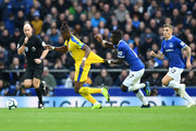 Wilfried Zaha of Crystal Palace is challanged by Idrissa Gueye of Everton during the Premier League match between Everton FC and Crystal Palace at Goodison Park on October 21, 2018 in Liverpool, United Kingdom.