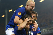 Seamus Coleman (R) of Everton celebrates with teammates Leighton Baines and Steven Naismith of Everton after scoring his team's second goal  during the UEFA Europa League match between Everton FC and VfL Wolfsburg on September 18, 2014 in Liverpool, United Kingdom.