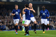 Leighton Baines #3 of Everton celebrates with fellow goalscorers Seamus Coleman (L) of Everton and Steven Naismith (2nd R) of Everton after scoring his team's third goal from the penalty spot during the UEFA Europa League Group H match between Everton and VFL Wolfsburg on September 18, 2014 in Liverpool, United Kingdom.