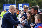 Steven Naismith and Seamus Coleman of Everton sign autographs for fans prior to the Barclays Premier League match between Everton and Manchester United at Goodison Park on October 17, 2015 in Liverpool, England.