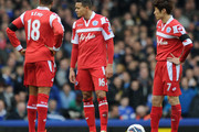 (L-R) Loic Remy, Jermaine Jenas and Ji-Sung Park of QPR look dejected after conceding a second goal during the Barclays Premier League match between Everton and Queens Park Rangers at Goodison Park on April 13, 2013 in Liverpool, England.