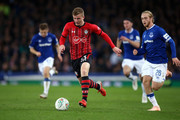 Matt Targett of Southampton runs with the ball under pressure from Tom Davies of Everton during the Carabao Cup Third Round match between Everton and Southampton at Goodison Park on October 2, 2018 in Liverpool, England.