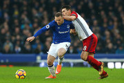 Wayne Rooney of Everton holds off Gareth Barry of West Bromwich Albion during the Premier League match between Everton and West Bromwich Albion at Goodison Park on January 20, 2018 in Liverpool, England.