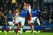 Gylfi Sigurdsson of Everton challenges Gareth Barry of West Bromwich Albion for the ball during the Premier League match between Everton and West Bromwich Albion at Goodison Park on January 20, 2018 in Liverpool, England.