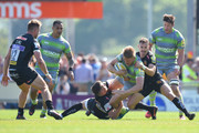 Nic White of Exeter Chiefs tackles Chris Harris of Newcastle Falcons  during the Aviva Premiership Semi Final between Exeter Chiefs and Newcastle Falcons at Sandy Park on May 19, 2018 in Exeter, England.