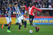 Gareth Barry of West Bromwich Albion challenges Hiram Boateng of Exeter City during the The Emirates FA Cup Third Round match between Exeter City and West Bromwich Albion at St James Park on January 6, 2018 in Exeter, England.