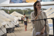 United Nations High Commissioner for Refugees (UNCHR) Special Envoy Angelina Jolie waves during a press conference after visiting a refugee camp in the border between Colombia and Venezuela on June 8, 2019 in Maicao, Colombia. UN and International Organization for Migration (IOM) announced yesterday that 4 million of Venezuelans have left their country since 2015 due to the social, political and economic crisis, which means they are of the single largest population groups displaced from their country globally. The camp in Maicao has 60 tents  which can accommodate up to 350 people. Due to high demand, UNHCR is considering an expansion to give shelter to 1,400 people. Colombia it the top host of Venezuelan migrants and refugees, accounting 1.3 million.