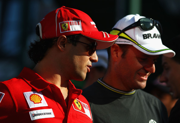 Felipe Massa (L) of Brazil and Ferrari and Rubens Barrichello (R) of Brazil and Brawn GP walk down the paddock following practice for the Hungarian Formula One Grand Prix at the Hungaroring on July 24, 2009 in Budapest, Hungary.