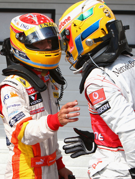 Fernando Alonso (L) of Spain and Renault talks with Lewis Hamilton (R) of Great Britain and McLaren Mercedes in parc ferme after qualifying first for the Hungarian Formula One Grand Prix at the Hungaroring on July 25, 2009 in Budapest, Hungary.