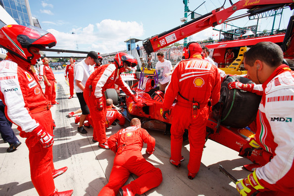 Ferrari mechanics recover the car of Felipe Massa of Brazil and Ferrari following his accident during qualifying for the Hungarian Formula One Grand Prix at the Hungaroring on July 25, 2009 in Budapest, Hungary.