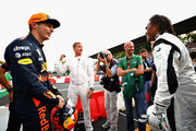 Max Verstappen of Netherlands and Red Bull Racing talks with David Coulthard and Christian Karembeu at a karting event during previews for the Formula One Grand Prix of Italy at Autodromo di Monza on August 31, 2017 in Monza, Italy.