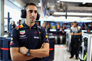 Sebastien Buemi of Switzerland and Red Bull Racing looks on in the garage during practice for the Formula One Grand Prix of Singapore at Marina Bay Street Circuit on September 14, 2018 in Singapore.
